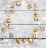 Christmas garland lights. With baubles on wooden rustic background Royalty Free Stock Image