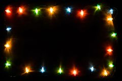 Christmas garland lights on blue wooden background Royalty Free Stock Image