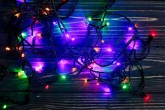 Christmas garland lights. colorful stylish border on black rusti Stock Photo