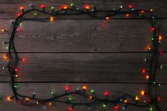 Christmas garland lights on grey background, copy space. Christmas composition royalty free stock images