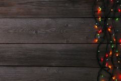 Christmas garland lights on grey background, copy space. Christmas composition royalty free stock image