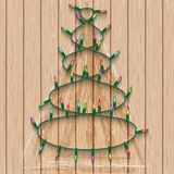 Christmas garland with lights on seamless wooden background from pine Royalty Free Stock Photos