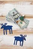 Christmas garland made of hundred dollar bills Stock Photos