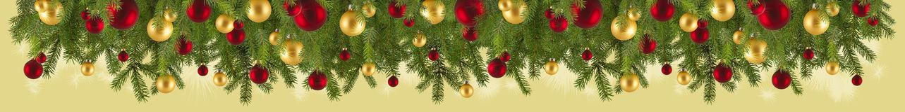 Christmas garland with ornaments and fir branches. Isolated Royalty Free Stock Image