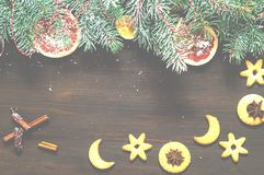 Christmas garland of pine branches and festive cookies on wooden background. New Year and Christmas card. royalty free stock photography