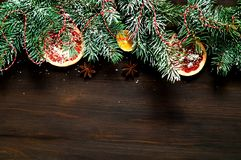 Christmas garland of pine branches on wooden background. New Year and Christmas card. royalty free stock photos