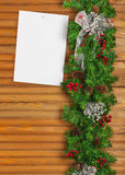 Christmas garland from pine tree and sheet of paper. Royalty Free Stock Images