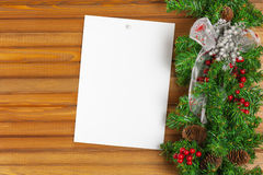Christmas garland from pine tree and sheet of paper. Royalty Free Stock Photo
