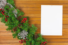 Christmas garland from pine tree and sheet of paper. Royalty Free Stock Image