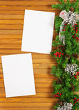 Christmas garland from pine tree and sheets of paper. Stock Images