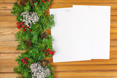 Christmas garland from pine tree and sheets of paper. Royalty Free Stock Images