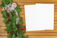 Christmas garland from pine tree and sheets of paper. Royalty Free Stock Image