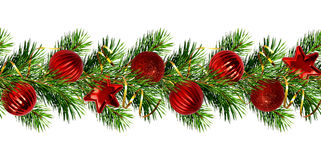 Christmas garland from pine tree twigs and red balls. Isolated on white. Seamless pattern Royalty Free Stock Photography