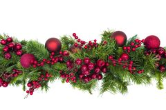 Christmas Garland with Red Berries and Baubles Isolated on White Royalty Free Stock Image