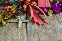 Christmas garland on rustic wooden background with copy space. Stock Photography