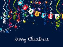 Christmas garland with serpentine and multi-colored lights on blue background Stock Image