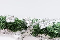 Christmas garland with silver gift boxes Royalty Free Stock Images