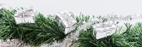 Christmas garland with silver gift boxes Royalty Free Stock Photo