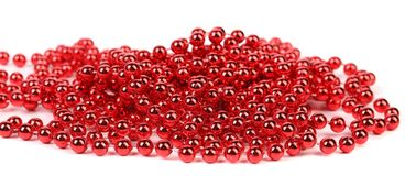 Christmas garland of small red beads. Royalty Free Stock Photos