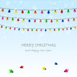 Christmas garland and snow Royalty Free Stock Photography