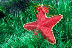 Christmas garland and star shaped bauble background Stock Photos