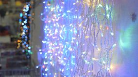 Christmas garland at the store. Holiday decorations stock video