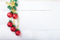 Christmas garland with toys. Red balls on white background, with space for text Stock Image