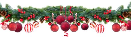 Christmas garland on white. Christmas garland with red hanging balls, cones and berries on isolated white background stock images