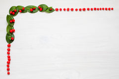 Christmas garland with winter berries Stock Photos
