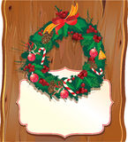 Christmas garland on wooden background. A Christmas garland on wooden background Stock Image