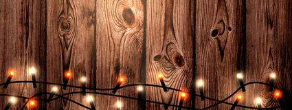 Christmas garland on wooden background banner.