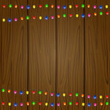 Christmas garland on wooden background Stock Photos