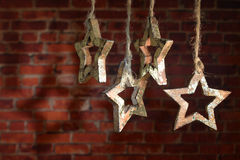 Christmas garland of wooden star. Royalty Free Stock Photo