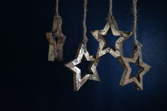 Christmas garland of wooden stars. Royalty Free Stock Photography