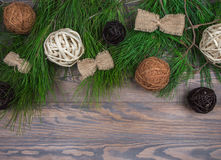 Christmas garlands of fir and pine branches on wooden background Stock Photos