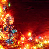 Christmas garlands of lamps on a wooden background. Stock Image