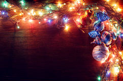 Christmas garlands of lamps on a wooden background. Royalty Free Stock Photo