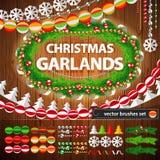 Christmas Garlands Set on Wood Background Stock Images