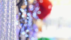 Christmas garlands swing and twinkle, Christmas toys, slow camera, hitting the top and bottom, blur, bokeh. Christmas garlands slowly swing and flicker stock video