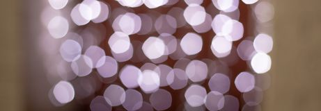 Bokeh Christmas background of abstract Christmas decoration with blue light and white glitter. Christmas garlands with white decoration on holiday background stock image