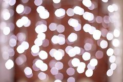Bokeh Christmas background of abstract Christmas decoration with blue light and white glitter. Christmas garlands with white decoration on holiday background stock images