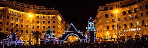 Christmas gathering in the city. A christmas decoration,and buildings,and people,in a christmas event,in the town center,in a town in Greece,Thessaloniki Royalty Free Stock Photography