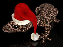 Christmas gecko. A computer generated image of a gecko with a Santa Claus hat stock illustration