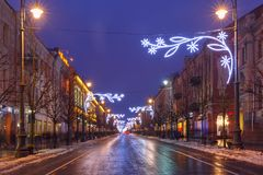 Christmas Gediminas prospect, Vilnius, Lithuania. Decorated and illuminated Christmas Gediminas prospect and Cathedral Belfry during evening blue hour, Vilnius Royalty Free Stock Photography