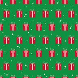 Christmas geometric seamless pattern with gift boxes. Christmas geometric seamless pattern with gift boxes and curved stars on green background. Vector Royalty Free Stock Photography
