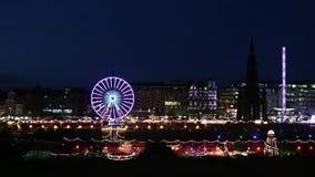 Christmas German market bright lights in Edinburgh on Princess Street at night, Scotland stock video