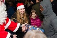 Christmas at German refugee camp. Scharnhausen, Germany - December 20, 2015: Refugees from Libya, Nigeria, Afghanistan, Pakistan, Eritrea, Gambia, Togo, Algeria Stock Photos