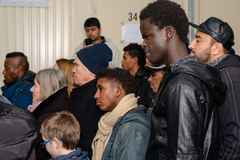 Christmas at  German refugee camp. Scharnhausen, Germany - December 20, 2015: Refugees from Libya, Nigeria, Afghanistan, Pakistan, Eritrea, Gambia, Togo, Algeria Stock Photography