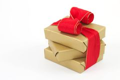 Christmas gift 1. Three golden gifts with a white background Royalty Free Stock Images