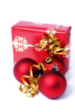 Christmas gift. Red and gold holiday gift and red decorations with gold ribbon stock photo